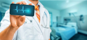 Technology in Health and Medicine Concept. Doctor With Smartphone With Medical App In Hospital. Unrecognizable man doctor in a white coat with a stethoscope Stock Images