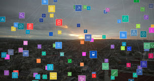 Composite image of technology icons. Technology icons against high angle view of cityscape against sky Stock Photo
