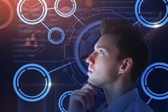 Technology, innovation and future concept. Thoughtful young businessman with digtal business interface. Technology, innovation and future concept. Double royalty free stock photos