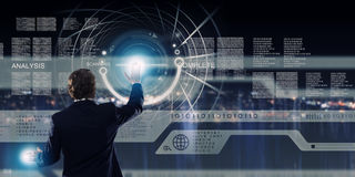Technology innovations. Businessman in suit against digital background with icons Stock Images