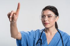 Creative  female doctor coming up with idea Stock Photography