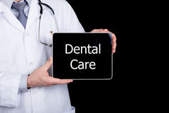 Free Technology, Internet And Networking In Medicine Concept - Doctor Holding A Tablet Pc With Dental Care Sign. Internet Stock Images - 71597604