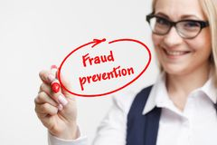 Technology, internet, business and marketing. Young business woman writing word: fraud prevention Royalty Free Stock Images