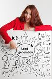 Technology, internet, business and marketing. Young business woman writing word: Lead generation. Technology, internet, business and marketing. Young business Royalty Free Stock Photo