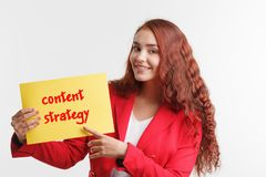 Technology, internet, business and marketing. Young business woman writing word: content strategy stock photos