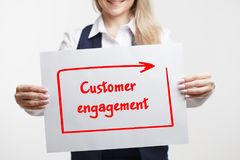 Technology, internet, business and marketing. Young business woman writing word: Customer engagement. Technology internet business and marketing. Young business royalty free stock photos