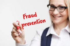 Technology, internet, business and marketing. Young business woman writing word: fraud prevention Stock Photo