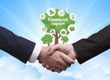 Technology, the Internet, business and network concept. Business. Men shake hands: Financial report Stock Photos