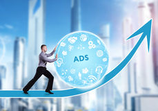 Technology, the Internet, business and network concept. A young. Businessman overcomes an obstacle to success: ADS Stock Image
