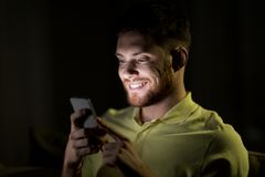 Happy young man with smartphone at night Royalty Free Stock Photo