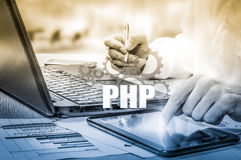 Technology and internet concept - businessman holds the php button on virtual screens Stock Images