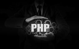 Technology and internet concept - businessman holds the php button on virtual screens Stock Photos