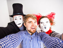 Technology internet and happiness concept. Young men and mime taking self picture selfie with smartphone camera Royalty Free Stock Photo