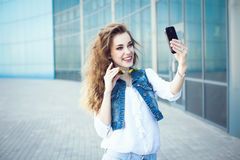 Technology internet and happy people concept - beautiful girl ta Stock Photos