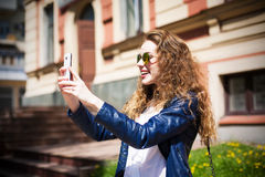Technology internet and happy people concept - beautifull girl i Stock Image