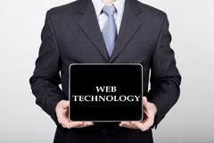 Technology, internet and networking in business concept - businessman holding a tablet pc with web technology sign Royalty Free Stock Image