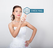 Technology, internet and networking concept. Beautiful bride in fashion wedding dress. Bride presses check mail button Stock Photography