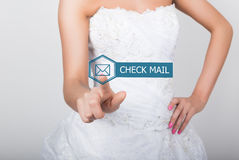 Technology, internet and networking concept. Beautiful bride in fashion wedding dress. Bride presses check mail button Stock Photos