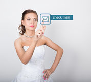Technology, internet and networking concept. Beautiful bride in fashion wedding dress. Bride presses check mail button Stock Photo