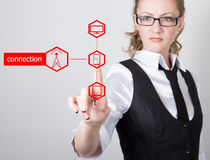 Technology, internet and networking concept. beautiful woman in a black business shirt. woman presses connection button Stock Image