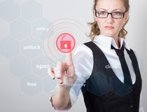 Technology, internet and networking concept. beautiful woman in a black business shirt. woman presses lock button on Stock Image
