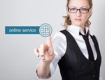Technology, internet and networking concept. beautiful woman in a black business shirt. woman presses online service Royalty Free Stock Images