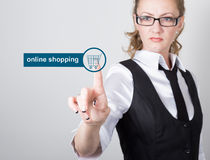 Technology, internet and networking concept. beautiful woman in a black business shirt. woman presses online shopping Royalty Free Stock Photography