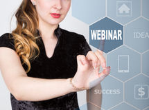 Technology, internet and networking concept. beautiful woman in a black business shirt. woman presses webinar button on Royalty Free Stock Photos