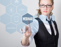 Technology, internet and networking concept. beautiful woman in a black business shirt. woman presses webinar button on Stock Photos