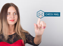 Technology, internet and networking concept. beautiful woman in a red dress with lace sleeves. woman presses check mail Stock Image