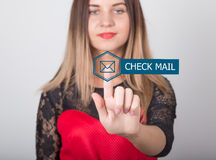 Technology, internet and networking concept. beautiful woman in a red dress with lace sleeves. woman presses check mail Stock Photo