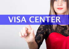 Technology, internet and networking concept. beautiful woman in a red dress with lace sleeves. woman presses visa center Royalty Free Stock Image