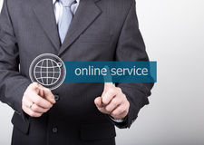 Technology, internet and networking concept - Businessman presses online service button on virtual screens. Internet Royalty Free Stock Photo