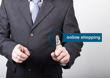Technology, internet and networking concept - Businessman presses online shopping button on virtual screens. Internet Royalty Free Stock Image