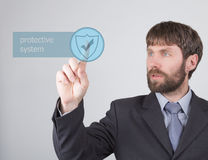 Technology, internet and networking concept - Businessman presses protective system button on virtual screens. Internet Royalty Free Stock Photography