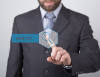 Technology, internet and networking concept - Businessman presses search button on virtual screens. Internet Stock Photo