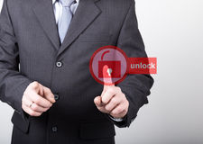 Technology, internet and networking concept - Businessman presses unlock button on virtual screens. Internet Stock Image