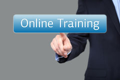 Technology, internet and networking concept - businessman pressing online training button on virtual screens Stock Images