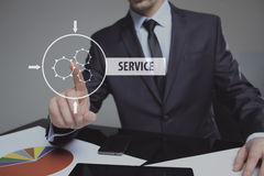 Technology, internet and networking concept - businessman pressing service button on virtual screens Royalty Free Stock Photography