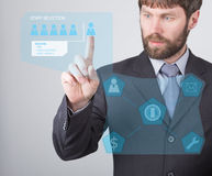 Technology, internet and networking concept - businessman reading a summary of the applicant employee on virtual screens Royalty Free Stock Photos