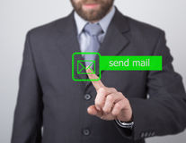 Technology, internet and networking concept. man in a black business shirt. woman presses send mail button on virtual Royalty Free Stock Images