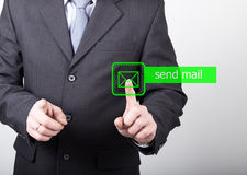 Technology, internet and networking concept. man in a black business shirt. woman presses send mail button on virtual Royalty Free Stock Photos