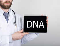 Technology, internet and networking in medicine concept - Doctor holding a tablet pc with dna sign. Internet Royalty Free Stock Photography