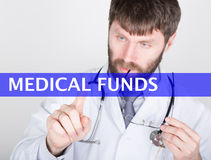 Technology, internet and networking in medicine concept - medical doctor presses medical funds button on virtual screens. Internet technologies in medicine Stock Image