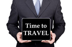 Technology, internet and networking in tourism concept - businessman holding a tablet pc with time to travel sign. Internet technologies in business and Stock Photos