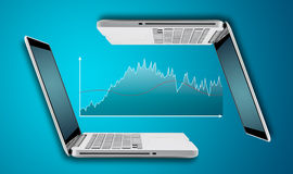 Technology laptop computer with graph finance forex chart Stock Photography