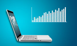 Technology laptop computer with graph finance forex chart Royalty Free Stock Photo