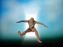 Technology Leap. Circuit skinned man leaps from doorway Royalty Free Stock Photo