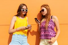 Teenage girls with smartphones in summer outdoors Royalty Free Stock Image