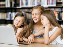 Technology in the library Royalty Free Stock Images